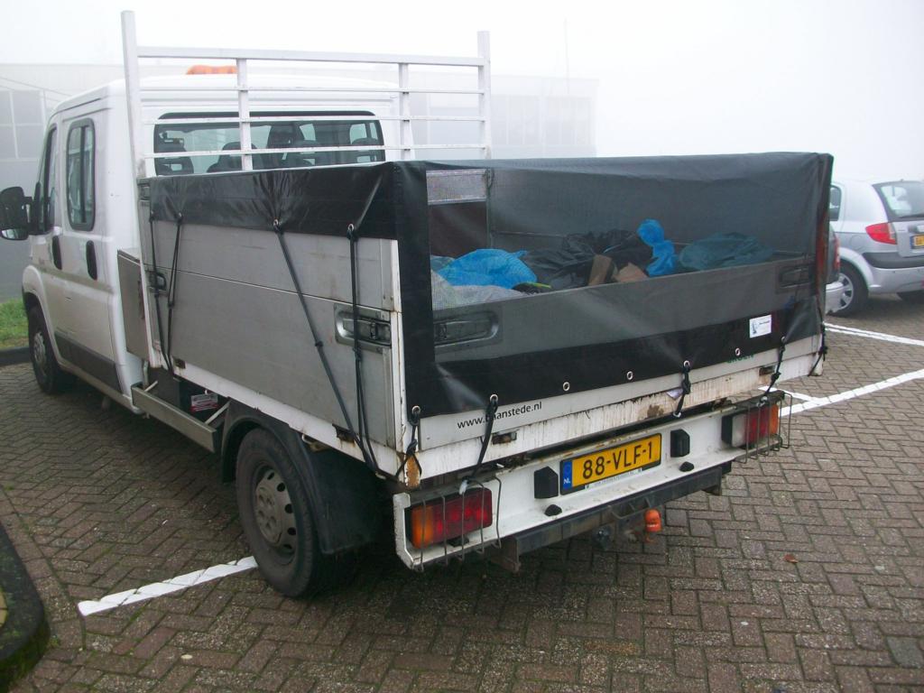 zwart afdekgaas aanhangwagen